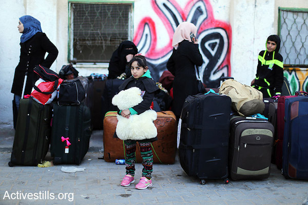 A small girls waits with her family at the Rafah border crossing hoping to leave the Gaza Strip into Egypt, February 13, 2016. (Ezz Al Zanoon/Activestills.org)