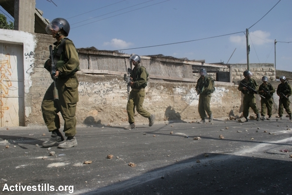 Illustrative photo of Israeli soldiers inside a Palestinian village. (Oren Ziv/Activestills.org)