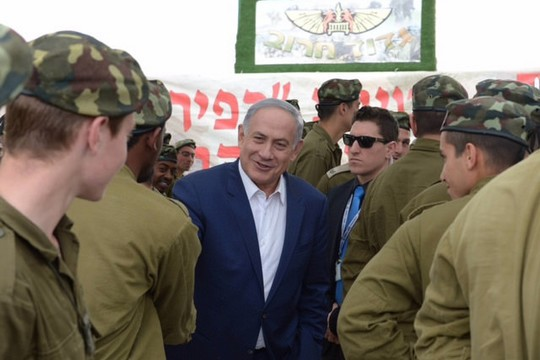 Prime Minister Netanyahu meets soldiers from the Kfir Brigade on the Jewish holiday of Purim. (photo: Amos Ben Gershon/GPO)