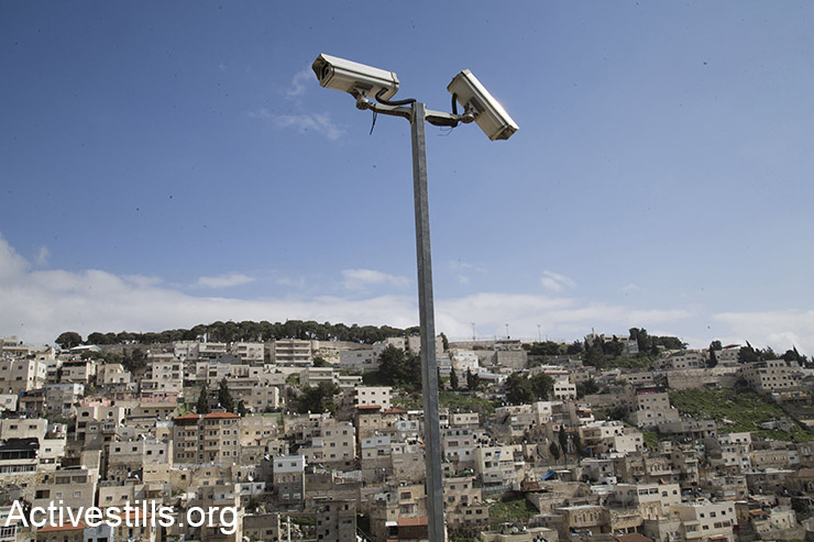 Israeli security cameras posted in the East Jerusalem neighborhood of Silwan, February 21, 2016. (Activestills.org)