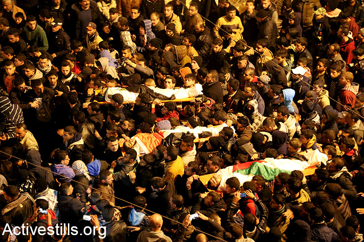 Hundreds of Palestinians take part in the funeral of the three Palestinian youths killed during a shooting attack on Israeli security forces, Qabatiya, near Jenin, West Bank, February 5, 2016. The three youths shot and stabbed several Israeli Border Policemen in East Jerusalem the previous day. (Activestills.org)
