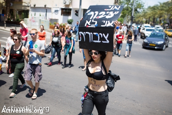 "A woman with ""my body, my rules"" written on her at the SlutWalk against sexism in Tel Aviv, May 9, 2014. SlutWalks have been held in cities across the world as a symbol of defiance against sexism and sexual violence. (Yotam Ronen/Activestills.org)"