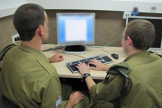 Israeli soldiers working on a computer. (IDF Spokesperson)