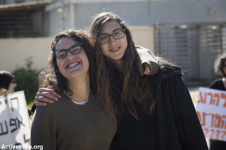 Young Israeli women Tair Kaminer and Tania Golan pose for a final photo outside the Tel Hashomer induction base where they announced their refusal to serve in the Israeli army, January 31, 2016. Kaminer was sentenced to prison.
