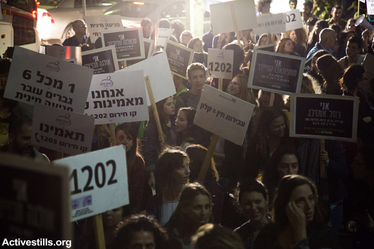Women and men hold a demonstration to mark the International Day for the Elimination of Violence against Women in Tel Aviv, October 25, 2015.