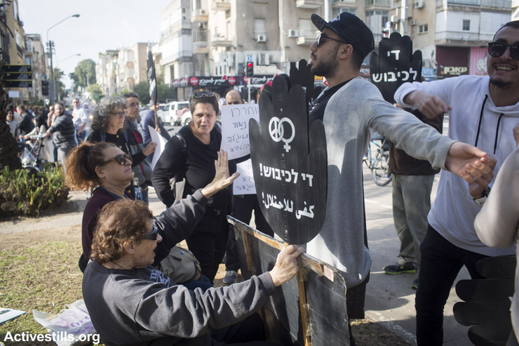 Right-wing Israelis confront members of 'Women in Black' during their weekly vigil against the occupation, central Tel Aviv, January 22, 2016. Women in Black have been holding weekly vigils against the occupation for two decades.