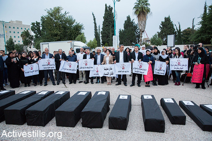 Palestinians citizens of Israel participate in a vigil in the town of Ramle marking the International Day for the Elimination of Violence against Women, on November 25, 2015. The protesters staged coffins to protest against domestic violence and the rise in numbers of women murdered by their husbands. (Activestills.org)