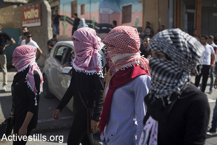 Palestinian women protesters march, during clashes with Israeli forces, in the West Bank city of Bethlehem, October 14, 2015.  (Activestills.org)