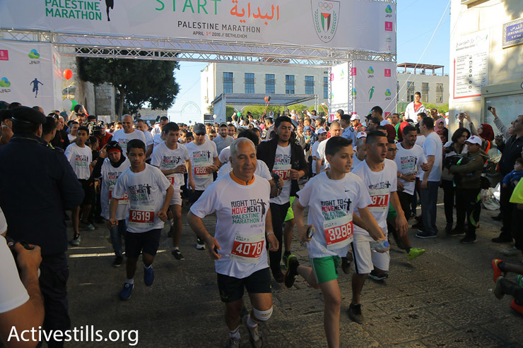 Runners at the starting line of the 2016 Palestine Marathon, Bethlehem, West Bank, April 1, 2016. (Ahmad al-Bazz/Activestills.org)