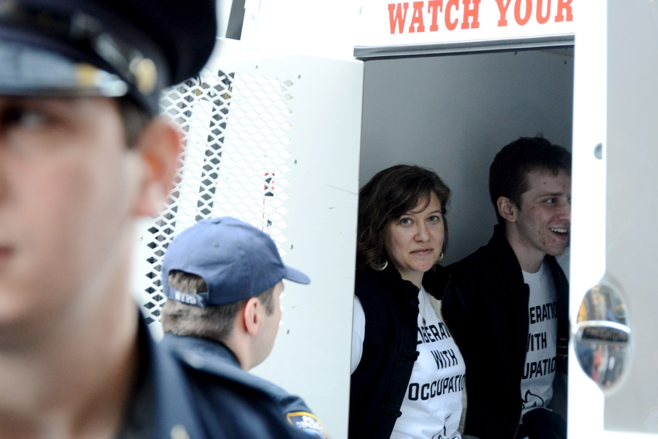 IfNotNow activists seen in a police van following an anti-occupation demonstration inside the Anti-Defamation League's offices. (Gili Getz)