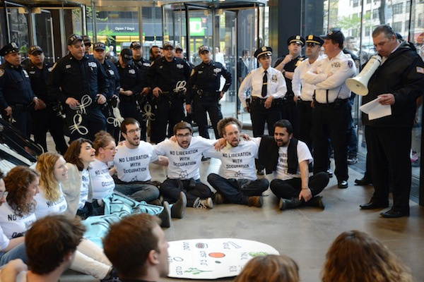 IfNotNow activists sit inside the offices of the Anti-Defamation League in New York City to protest the institution's support for Israel's occupation policies. (photo: Gili Getz)