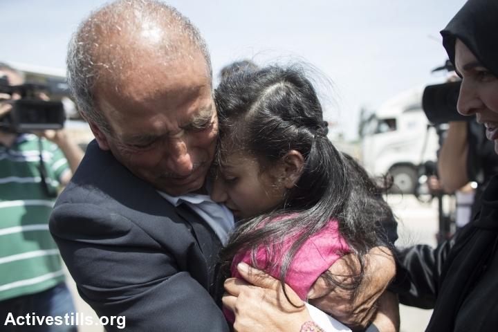 Dima al-Wawi is embraced by her father after being released form 75 days in an Israeli prison, Jabara checkpoint, West Bank, April 24, 2016. (Oren Ziv/Activestills.org)