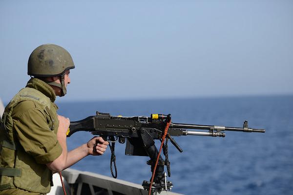 Illustrative photo of s sailor in the Israeli navy manning a machine gun. (IDF Spokesperson)