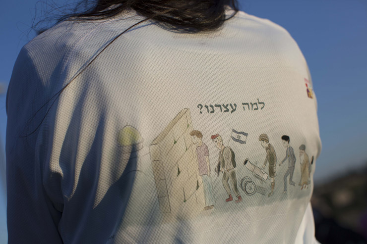 An attendee at the sacrifice ceremony wears a T-shirt that reads, 'Why did we stop?', suggesting that Israeli forces should have demolished Al-Aqsa Mosque when they conquered the Old City of Jerusalem and the Western Wall in 1967, at-Tur, East Jerusalem, April 18, 2016. (Tali Mayer/Activestills.org)