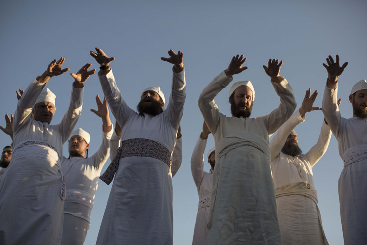 Cohanim, men said to be descended from the priestly tribe, perform the 'priestly blessing' during a 'practice run' of a pre-Passover Temple sacrifice, at-Tur, East Jerusalem, April 18, 2016. (Tali Mayer/Activestills.org)