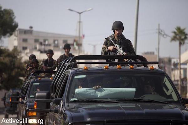 Members of the Palestinian Presidential Guard in a motorcade in Bethlehem, March 22, 2013. (Oren Ziv/Activestills.org)