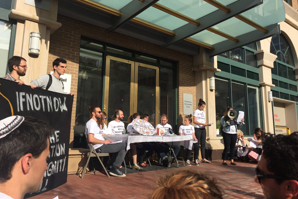 Members of IfNotNow hold a Liberation Seder in front of Hillel's headquarters in Washington D.C., April 19, 2016. (Courtesy photo)