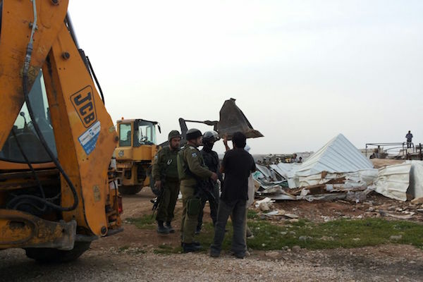 Israeli army forces demolish six Palestinian homes in the South Hebron Hills community of Umm el-Kheir, April 6, 2016. (Tarek Hadalin/B'Tselem)