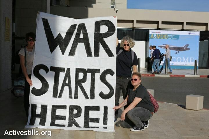 Anti-war activists protest against the The International Air Conference, outside the Tel Aviv Hilton, April 3, 2016. (photo: Oren Ziv/Activestills.org)