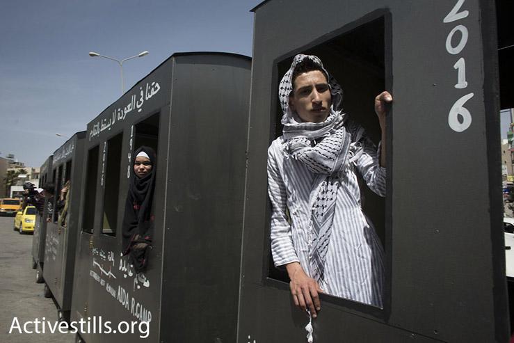 Palestinian youths ride the 'Return Train' through Bethlehem, May 15, 2016. (Oren Ziv/Activestills.org)