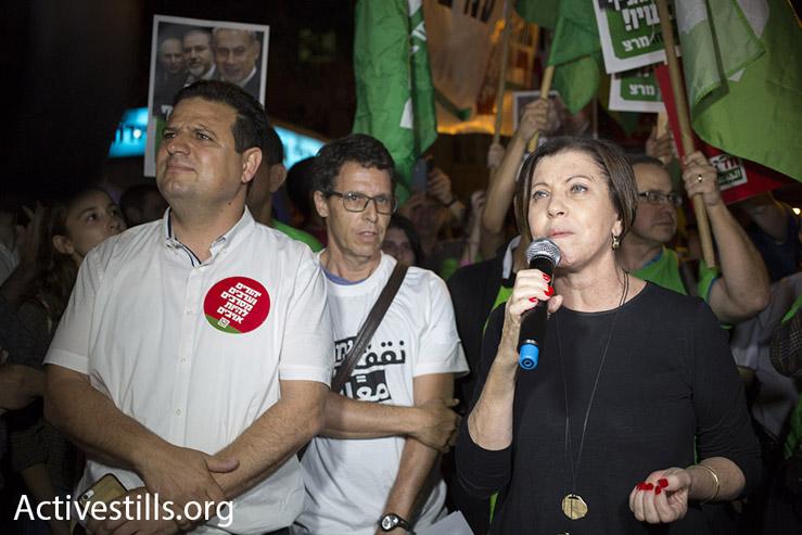 Hadash chairman Ayman Odeh (left) and Meretz chairwoman Zehava Galon speak at the left-wing protest in Tel Aviv, May 28, 2016. (Oren Ziv/Activestils.org)