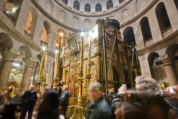 Tourists and worshipers visit the Church of the Holy Sepulcher in the Old City of Jerusalem. (Photo by Fat Jackey / Shutterstock.com)