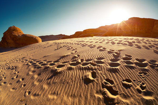 Footprints in the sand in the Sinai desert. (Dudarev Mikhail / Shutterstock.com)