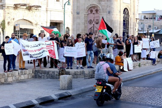 Dozens demonstrate for the release of Palestinian poet Dareen Tatour, Jaffa, Israel, July 26, 2016. (photo: Tawfik Tatour, father of Palestinian poet Dareen Tatour, who was arrested and put under house arrest, demonstrates for her release at Jaffa's Clock Tower Square, June 26, 2016. (photo: Haim Schwarczenberg)