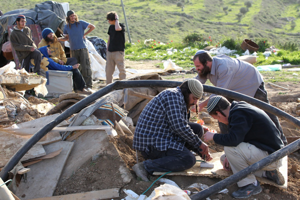 Illustrative photo of Israeli settlers rebuilding an illegal structure demolished by Israeli security forces. (Nati Shohat/Flash90)