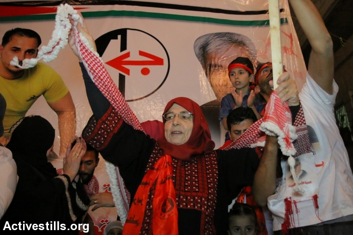 The mother of Palestinian prisoner Bilal Kayed takes part in a protest in solidarity with her son, in the village of Asira Ash Shamaliya, Nablus district, West Bank, June 18, 2016. (photo: Ahmad al-Bazz/Activestills.org)