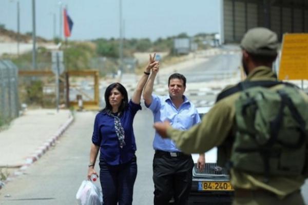 Joint List head Ayman Odeh accompanies Palestinian legislator Khalida Jarrar as she leaves Israeli prison after serving a 15-month sentence. (photo courtesy of the Joint List)
