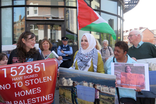 Protesters demand that Airbnb stop renting properties in West Bank Israeli settlements, Dublin, June 3, 2016. (Courtesy of JVP)