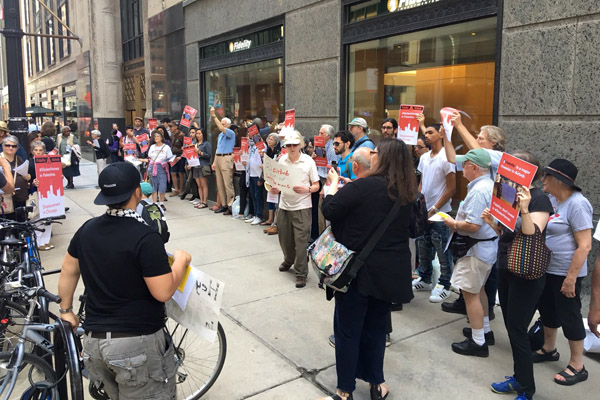 Protesters outside Fidelity Investment in Chicago demand that the company divest from Airbnb, June 3, 2016. (Courtesy of JVP)