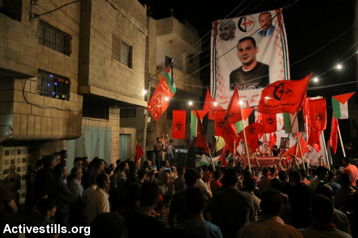 Palestinians take part in a protest in solidarity with the Palestinian prisoner Bilal Khaled, in the village of Asira Ash Shamaliya, Nablus district, West Bank, June 18, 2016.