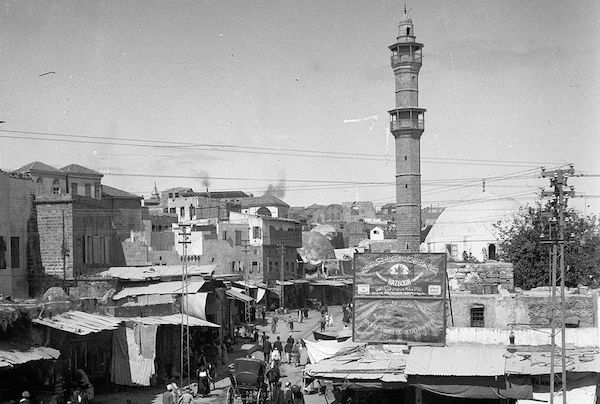 The market place in Jaffa, circa 1900. The photo has been taken from the Clock Tower Square, with Mahmoudiya Mosque in the background. (Library of Congress)