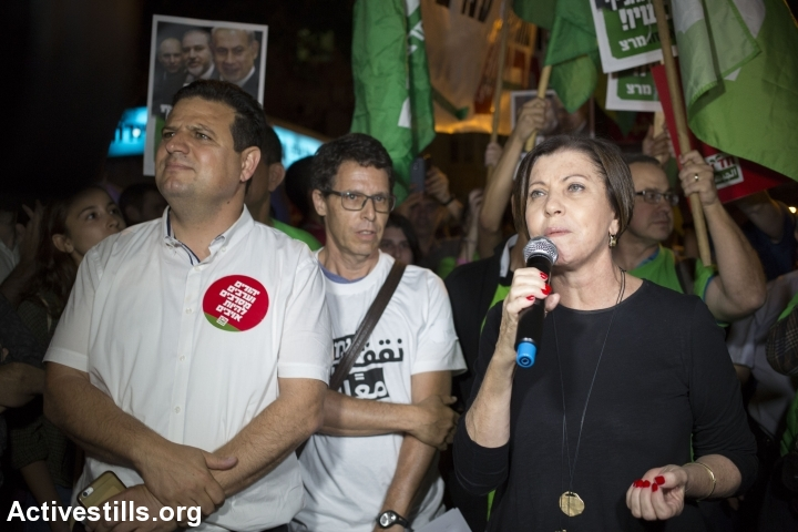 MK Zehava Galon, from Meretz, speaks as Jewish and Arab protesters march during a prtoest against the occupation, calling the Israeli government to resign, in cental Tel Aviv, May 28, 2016. (photo: Oren Ziv/Activestills.org)