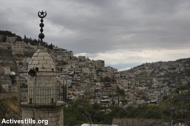 The East Jerusalem neighborhood of Silwan, home to tens of thousands of Palestinians, is an area of East Jerusalem Israel plans to hold onto. Israeli settlers and archeological groups have moved in in recent years, ensuring a Jewish-Israel presence. (Oren Ziv/Activestills.org)