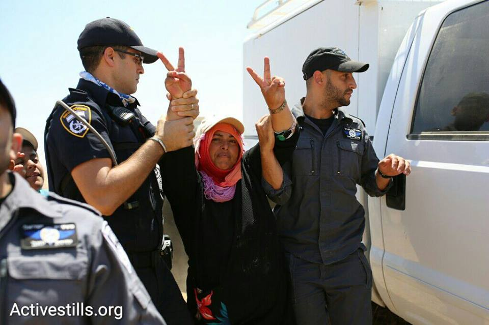 Israeli police detain a Bedouin woman during a march in the unrecognized Bedouin village of Al-Araqib, Negev Desert, July 24, 2016. (photo: Oren Ziv/Activestills.org)