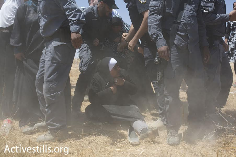Israeli police detain Bedouin women during a march in the unrecognized village of Al-Araqib, Negev Desert, July 24, 2016. (photo: Oren Ziv/Activestills.org)