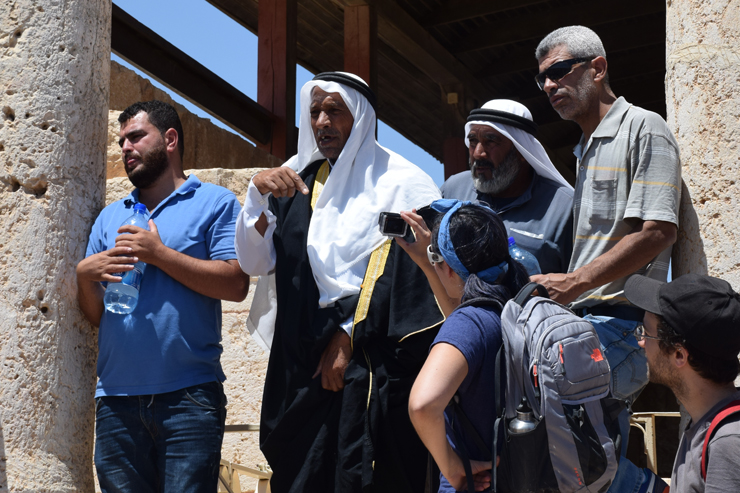 Elderly Palestinian residents of Susya tell their younger generations and activists from the Center for Jewish Non-Violence about life in the village before the Israeli army evicted them in order to turn it into an archeological park, Susya, South Hebron Hills, July 14, 2016. The oral histories were translated from Arabic into Hebrew and English. (Michael Schaeffer Omer-Man)