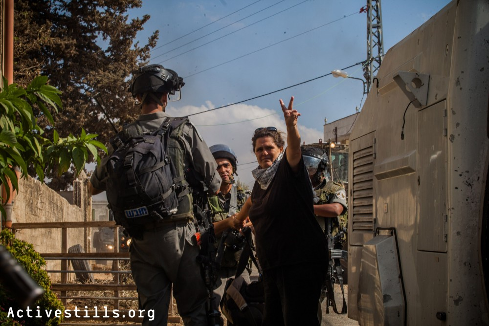 An Israeli activist is arrested by Israeli soldiers during the weekly demonstration against the occupation, Kafr Qaddum, West Bank, October 12, 2012.
