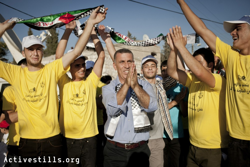 Palestinians from the West Bank village of Kafr Qaddum join to celebrate two years of the Popular Struggle in their village, July 4, 2013.