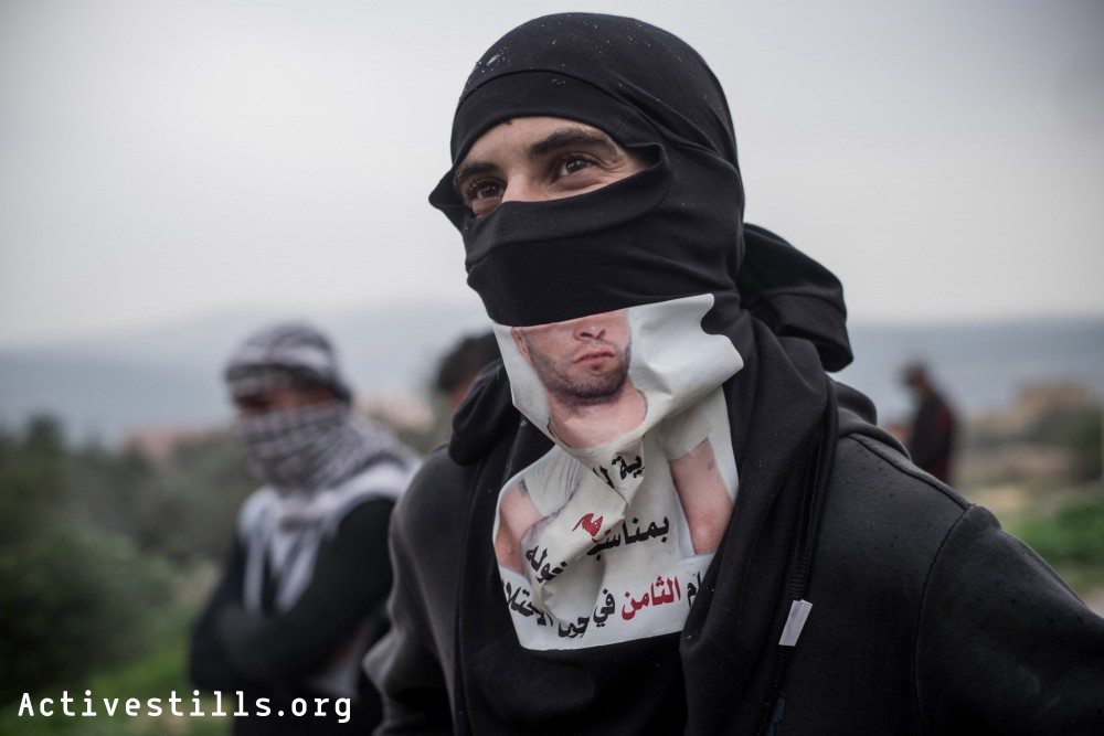 Palestinian youth seen during the weekly protest in Kafr Qaddum, a West Bank village located east of Qalqiliya, December 19, 2014.