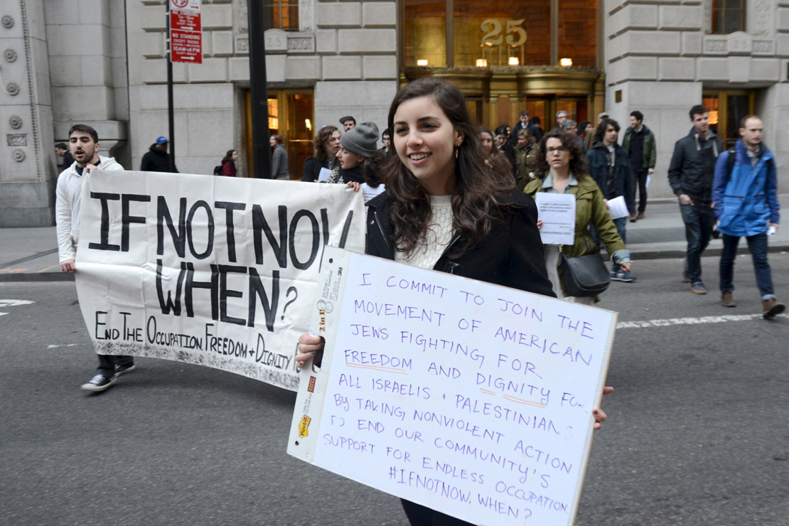 Simone Zimmerman holds a sign at an IfNotNow liberation Seder in New York, 2015. (Gili Getz) Read more about the group's liberation Seders here.