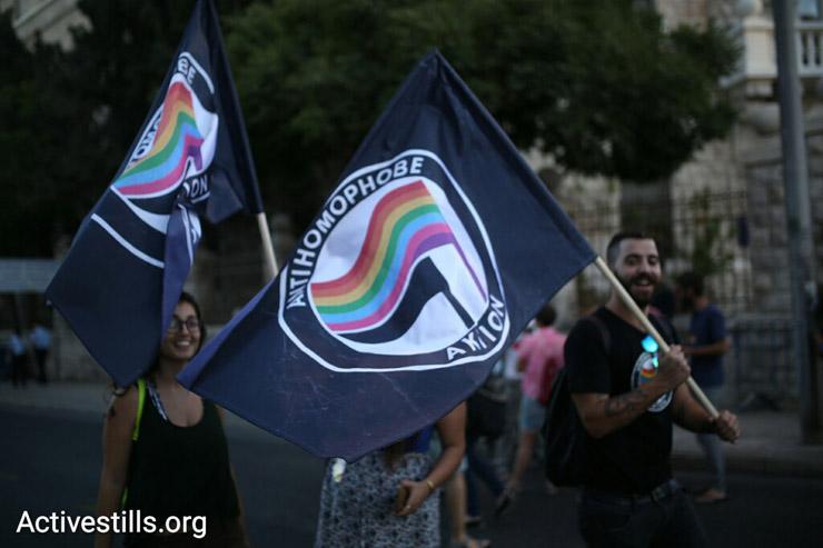 Participants wave Antifa flags at the Jerusalem Pride Parade, West Jerusalem, July 21, 2016. (Oren Ziv/Activestills.org)