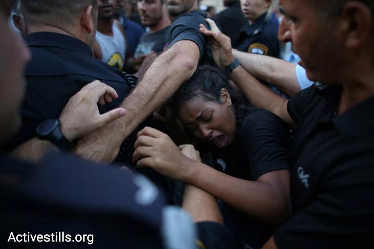 Police push demonstrators back during a protest against police brutality targeting Israelis of Ethiopian descent, July 3, 2016. (Oren Ziv/Activestills.org)