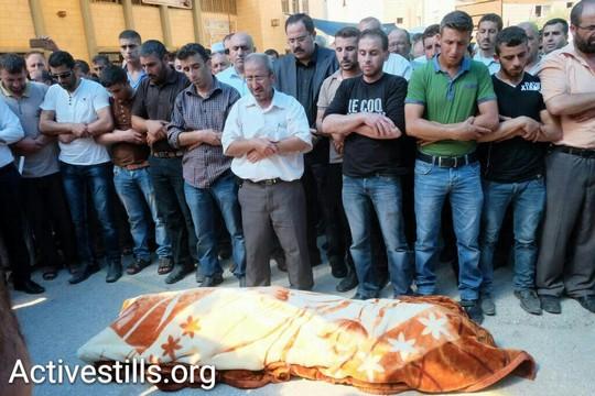 The funeral of Riham Dawabshe. (Yotam Ronen/Activestills.org)