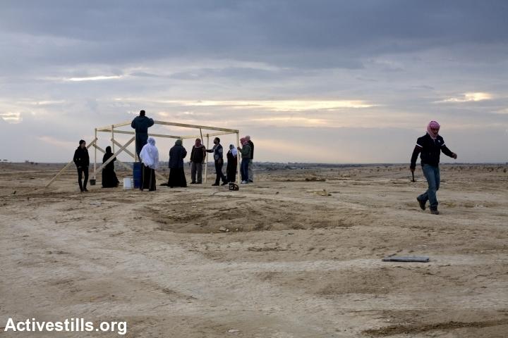 Residents of al-Araqib rebuild a structure demolished by Israeli authorities, January 16, 2011.(Keren Manor/Activestills.org)