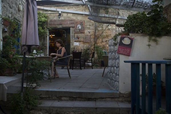 A coffee shop in Ein Hod, an 'artists colony' in northern Israel, July 16, 2016. Hundreds of Palestinians were expelled from the village during the 1948 War. (Lior Mizrahi/Flash90)