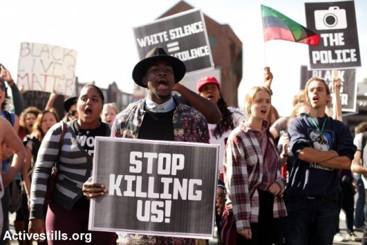 Activists march in Boston, Mass. on October 25, 2014, calling for an end to police racial profiling and violence. The protest came in the wake of events in Ferguson, Mo., following the fatal shooting by police of an unarmed black man. (Activestills.org)